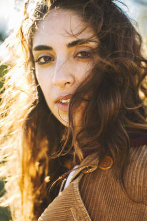 liberating: Portrait of young woman with wavy hair, close-up