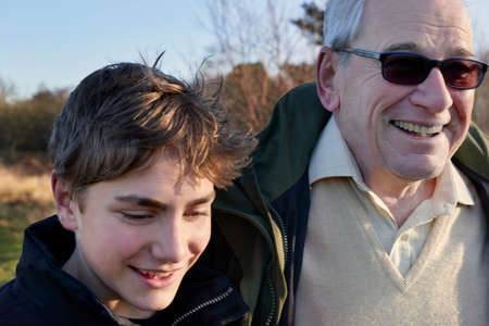 grampa: Grandfather and grandson walking through field