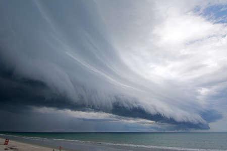 environmental issues: Arcus cloud above ocean, Satellite Beach, Florida, USA LANG_EVOIMAGES