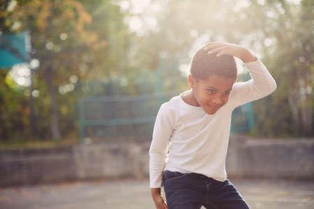 Elementary schoolboy dancing in school playground LANG_EVOIMAGES
