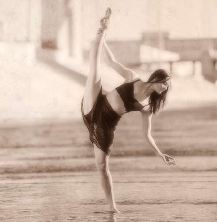 Young woman leg raised, balancing on one leg, b&w, Los Angeles, California, USA