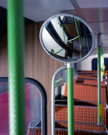 upstairs: Convex mirror and seats upstairs in vintage double decker bus