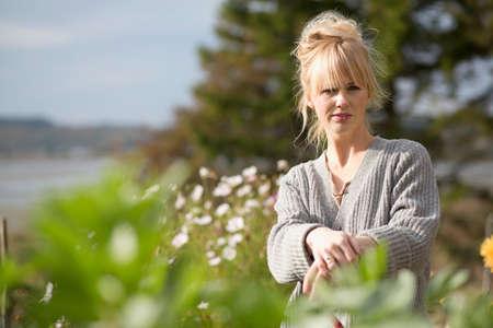 self sufficient: Portrait of woman in organic garden, Orust, Sweden