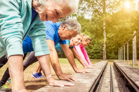 Group of adults exercising outdoors