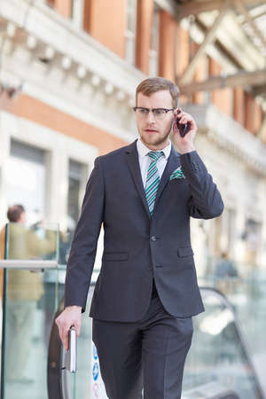 business: Front view of businessman using smartphone to make telephone call