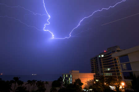 stormy waters: Lightning sparks over the hotels and Atlantic Ocean at Fort Lauderdale, Florida, USA