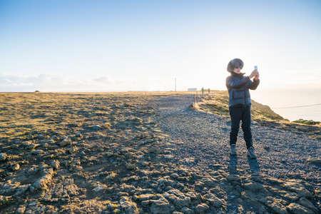 Mature woman enjoying view on hill, Iceland