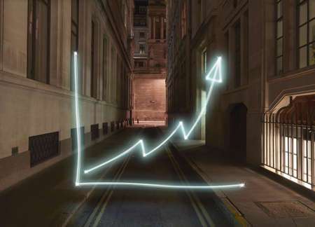 recuperating: Glowing chart with upward arrow symbol  on city street at night LANG_EVOIMAGES