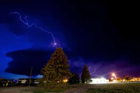 Lightning shoots out of an approaching supercell storm, Burlington, Colorado, USA LANG_EVOIMAGES