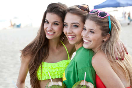brazilian ethnicity: Three young female friends at the beach