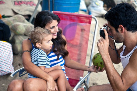 brazilian ethnicity: Mother and son,father taking photograph LANG_EVOIMAGES
