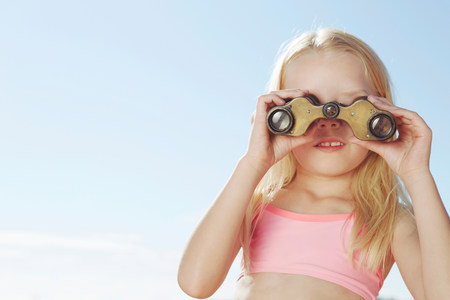 top 7: Girl looking through binoculars