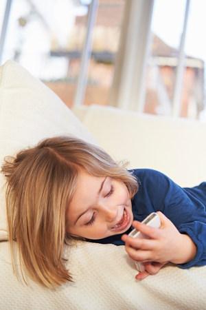 Girl on sofa using smartphone