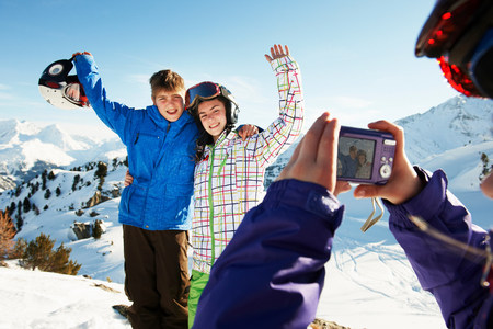 Girl photographing siblings,Les Arcs,Haute-Savoie,France