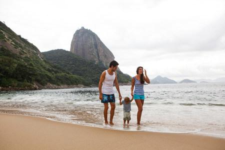 brazilian ethnicity: Family walking on beach holding hands,Rio de Janeiro,Brazil