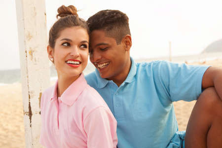 brazilian ethnicity: Portrait of young couple on beach LANG_EVOIMAGES