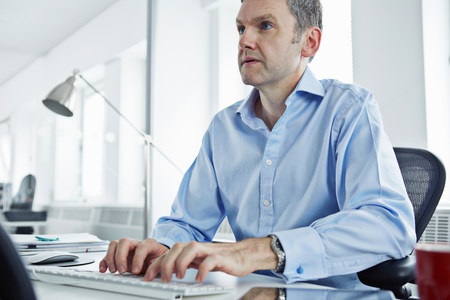 one mature man only: Mature businessman using computer LANG_EVOIMAGES
