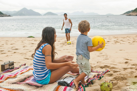 family: Family on beach with ball