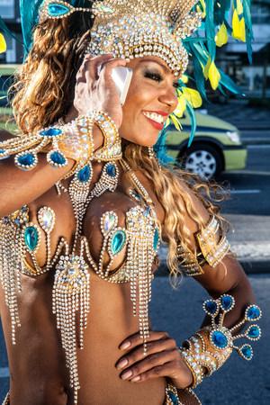 Samba dancer using cellphone,Ipanema Beach,Rio De Janeiro,Brazil