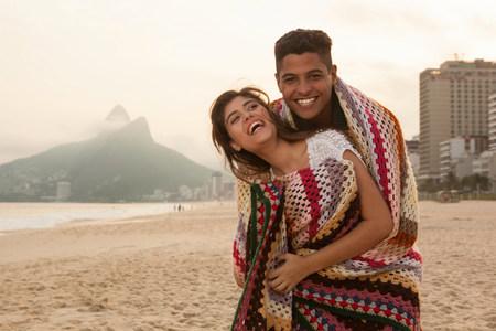 brazilian ethnicity: Young couple wrapped in blanket,Ipanema Beach,Rio de Janeiro,Brazil LANG_EVOIMAGES