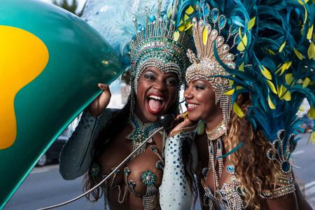 brazilian ethnicity: Samba dancers using pay phone,Ipanema Beach,Rio De Janeiro,Brazil