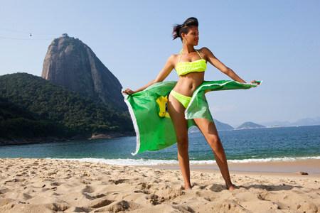 brazilian ethnicity: Man standing on beach with Brazilian flag,Rio de Janeiro,Brazil