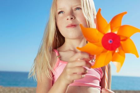 top 7: Girl holding toy windmill