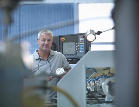 50 54 years:  Lathe operator working in factory,portrait