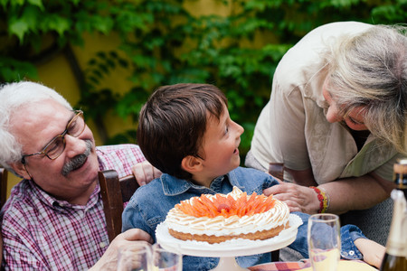 family: Grandparents surprising grandson with birthday cake LANG_EVOIMAGES