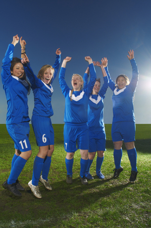 Female football team cheering