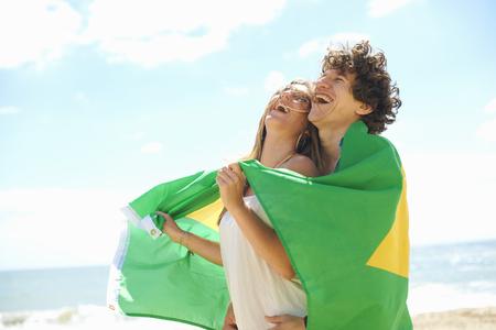 brazilian ethnicity: Couple with Brazilian flag