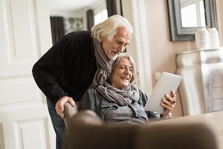 silver surfer: Senior couple with digital tablet LANG_EVOIMAGES