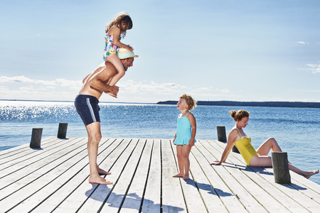 3 4 years: Parents and two young girls on pier,Utvalnas,Gavle,Sweden