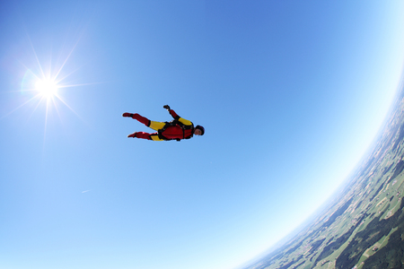 Skydiver free falling face down above Leutkirch,Bavaria,Germany