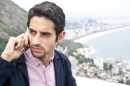 brazilian ethnicity: Young man on mobile,Casa Alto Vidigal,Rio De Janeiro,Brazil LANG_EVOIMAGES