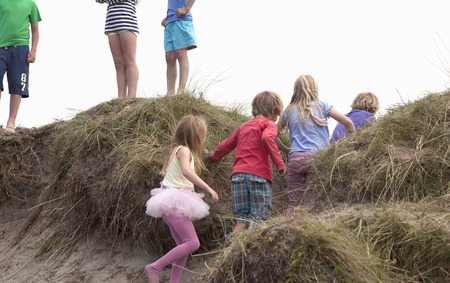 7 8: Group of friends on dunes,Wales,UK LANG_EVOIMAGES