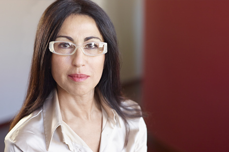 54: Portrait of businesswoman wearing glasses LANG_EVOIMAGES