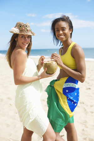 Women sharing coconut water