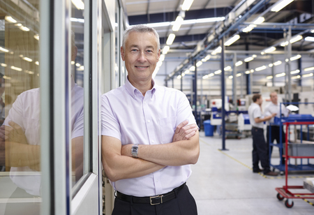 54: Portrait of manager with arms folded in engineering factory LANG_EVOIMAGES
