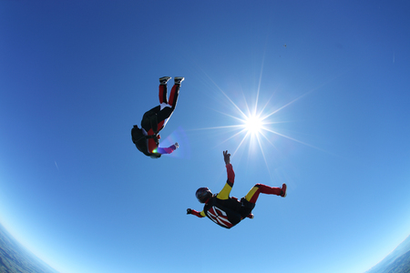 Skydivers upside down above Leutkirch,Bavaria,Germany LANG_EVOIMAGES