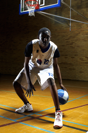 Portrait of basketball player bouncing ball