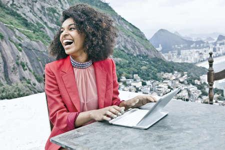 brazilian ethnicity: Young woman using laptop,Casa Alto Vidigal,Rio De Janeiro,Brazil