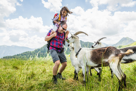 Father and daughter with goats,Tyrol,Austria