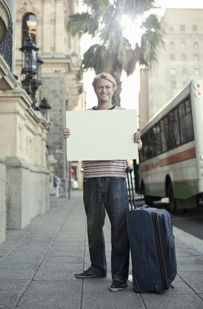 Young man holding blank white cardboard,Cape Town,South Africa