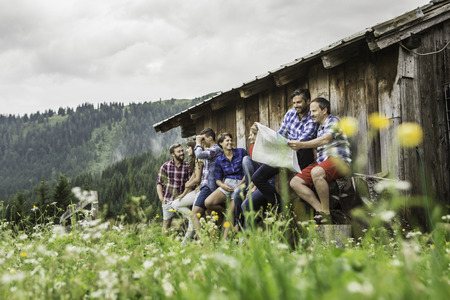 Group of friends chatting and reading map,Tirol,Austria LANG_EVOIMAGES