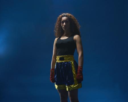 Studio portrait of female boxer in hand bandages LANG_EVOIMAGES