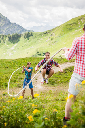 Young man skipping with rope,Tyrol,Austria