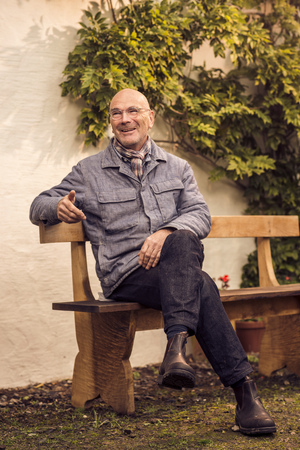 65 69 years: Senior man sitting on bench