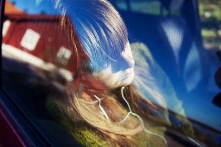 fedup: Teenage girl in car listening to music