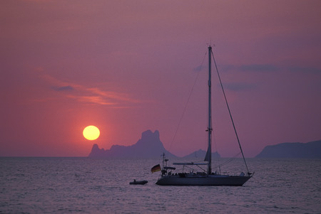 vedra: Boat at sunset against background of Es Vedra,Formentera,Balearic Islands,Spain LANG_EVOIMAGES